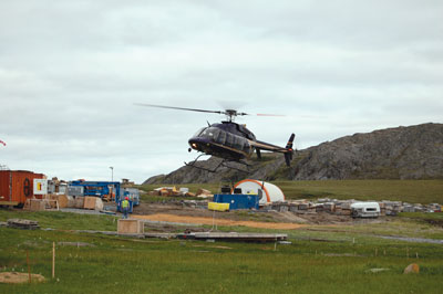 wisk-air-bell-407-at-mining-camp-about-to-airlift-equipment